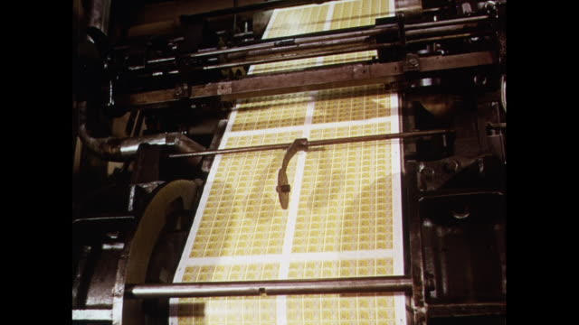 montage inspection of printed postage stamps in united kingdom - briefmarke stock-videos und b-roll-filmmaterial