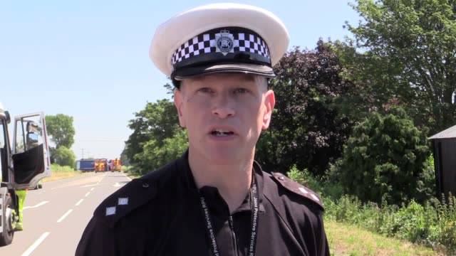 Inspector Jamie Langwith of Cambridgeshire Police confirms two men were fatally injured in a crash involving a double decker bus and a Bretts...
