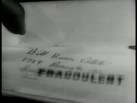 inspector stamping envelopes w/ 'fraudulent' stamp ms male hands stamping envelopes in pile w/ 'fraudulent' stamp - 1937 stock videos and b-roll footage