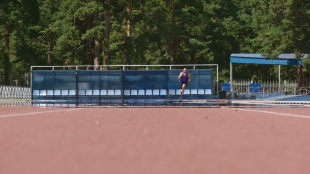 Inspiring Paralympic athlete running on track