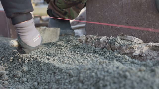 installation of a curb on a footpath. - stone material stock videos & royalty-free footage