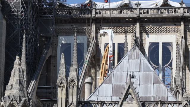 installation of a wooden beam in the shape of an arch to support the buttressing arches of the nave of the notre dame de paris cathedral july 2 2019... - architecture stock videos & royalty-free footage