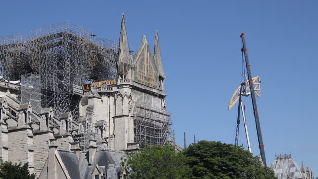installation of a wooden beam in the shape of an arch to support the buttressing arches of the nave of the Notre Dame de Paris cathedral July 2 2019...