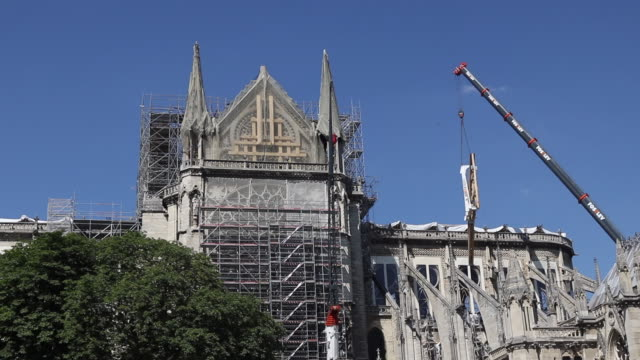 installation of a wooden beam in the shape of an arch to support the buttressing arches of the nave of the notre dame de paris cathedral , july 2,... - notre dame de paris stock videos & royalty-free footage