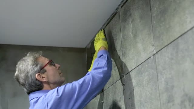 installation of ceramic tiles in a bathroom. - glue stock videos and b-roll footage