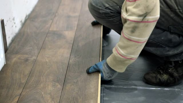 installation of laminate. - contractor stock videos and b-roll footage