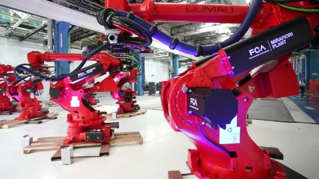 fca installed the first robot of the future 500 electric assembly line in its historic plant of mirafiori in turin on july 11 2019 the forecast is to... - quarter stock-videos und b-roll-filmmaterial