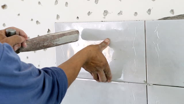 installing wall tile. - wall building feature stock videos & royalty-free footage