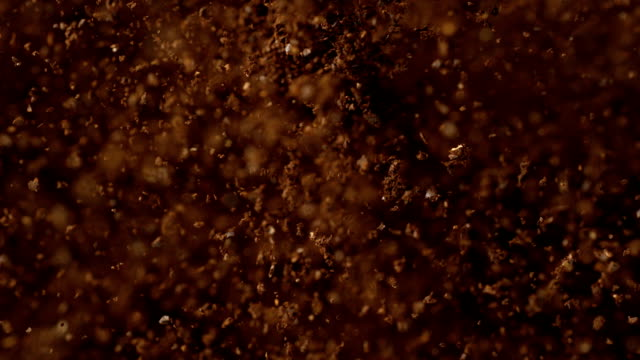 Instant coffee pieces falling and hitting ground