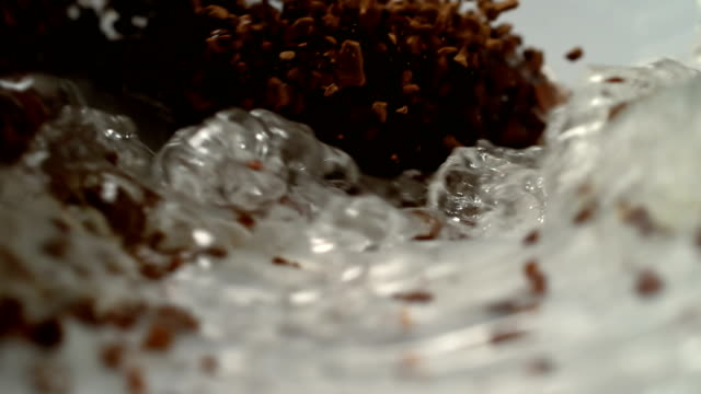 instant coffee pieces mixing with hot water - stirring stock videos & royalty-free footage