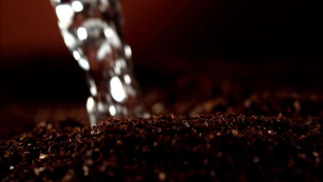 Instant coffee pieces mixing with hot water