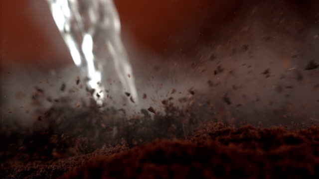 instant coffee pieces mixing with hot water - ground culinary stock videos & royalty-free footage