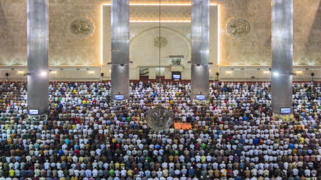 WS T/L Instiqal mosque, men praying during Friday prayers / Jakarta, Java, Indonesia