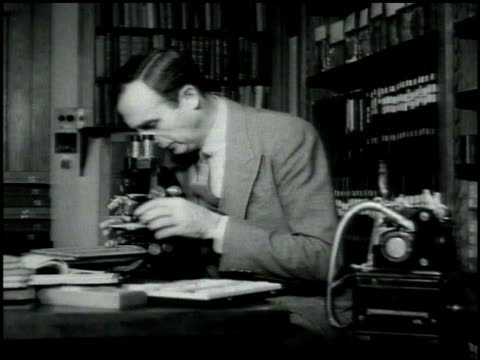 'Institute of Pathology Western Reserve University' sign on building Pathologist Dr Harry Goldblatt working at desk talking into dictating machine