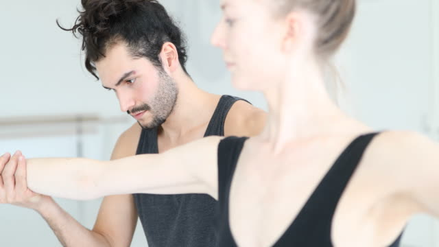 instructor adjusting arm of ballet dancer - ballet studio stock videos and b-roll footage