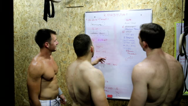 instructor and friends having a discussion in the gym - team sport stock videos & royalty-free footage