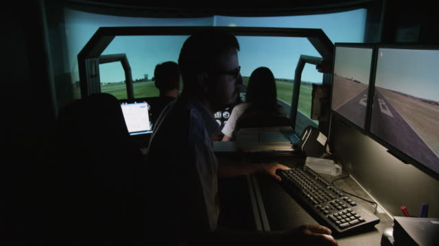 WS instructor and student pilots in helicopter flight simulator during take off from airport environment, RED R3D 4K