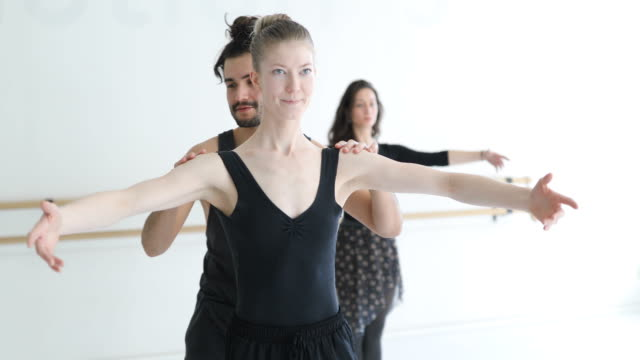 instructor assisting ballerina in dance class - posture stock videos & royalty-free footage