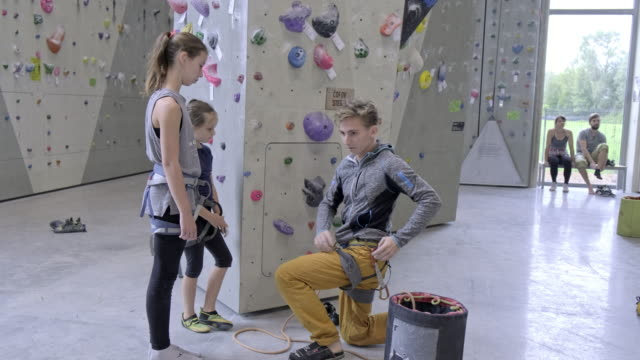 instructor at  climbing site - climbing wall stock videos & royalty-free footage