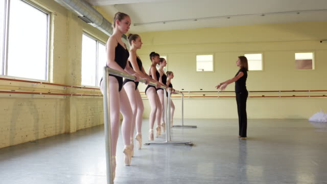 instructor coaching ballerinas at the barre - barre stock videos & royalty-free footage