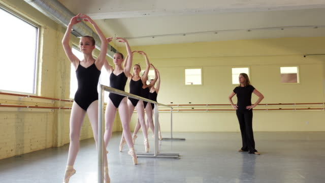 instructor coaching ballerinas at the barre - ballet shoe stock videos and b-roll footage