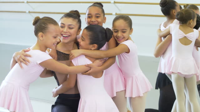 instructor greeting girls arriving to dance class - 8 9 years stock videos & royalty-free footage