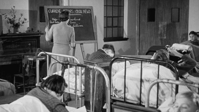 1949 montage instructor in hospital ward teaching school lessons to young patients lying in beds using typewriter, painting and writing / united kingdom - polio stock videos & royalty-free footage