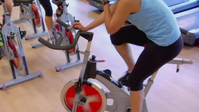 MS PAN Instructor leading spin class in fitness club/ San Antonio, Texas