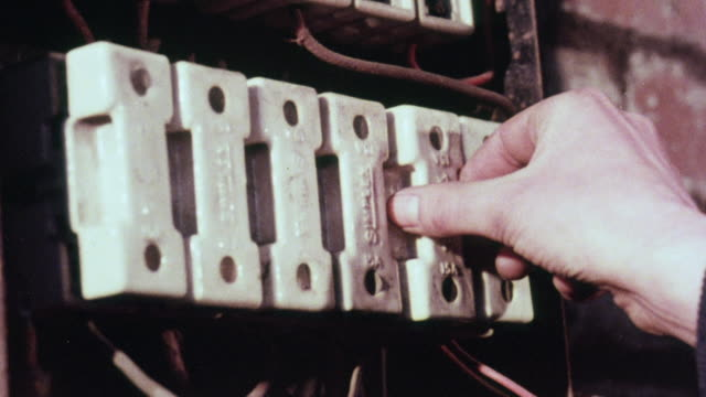 vídeos y material grabado en eventos de stock de montage instructor teaching an apprentice electrician how to wire switches / liverpool, england, united kingdom - herramienta de mano