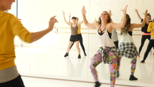 instructor teaching dance to students in class - dance studio stock videos & royalty-free footage