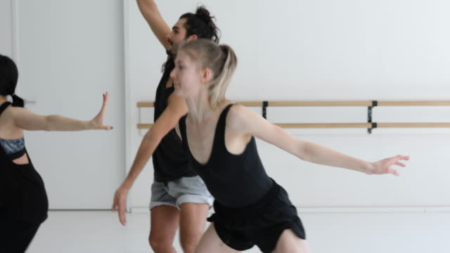 instructor training ballet dancers in dance studio - dance studio video stock e b–roll