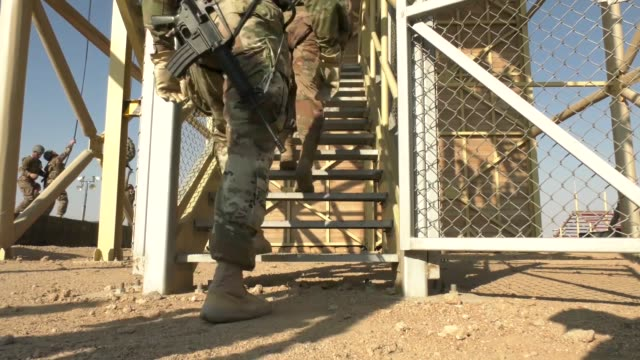 instructors from the army national guard warrior training center in fort benning georgia conduct rappel training during phase three of an air assault... - national guard stock videos and b-roll footage