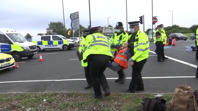 insulate britain' protesters arrested for blocking motorway junctions; england: london: hatfield: a1 junction: ext police cars and police officers on... - flash stock videos & royalty-free footage