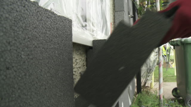 insulated polystyrene blocks being fitted onto a house - installing stock videos & royalty-free footage