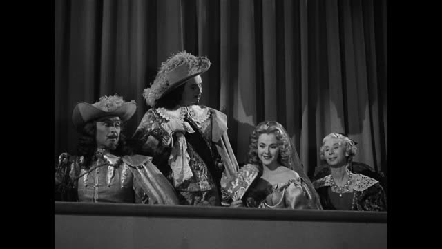 vídeos de stock, filmes e b-roll de insulting cyrano de bergerac (josé ferrer) causes a major interruption in the theater - ator