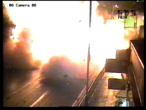 insurance coverage lib stills bomb exploding day wreckage of vehicle in street after bomb blast - ealing stock videos and b-roll footage