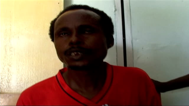 Insurgency brings bloodshed and chaos to Mogadishu Man cradling injured child interview SOT