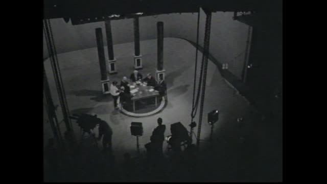 Int ATN7 Epping Television studio Harold Holt walks rubbing hands host William McMahon and Arthur Calwell seen with makeup bibs on / Harold Holt...