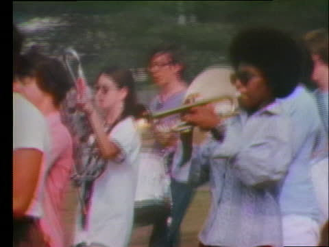 integrated children arrive at jefferson junior high school in pontiac michigan and play in a marching band rehearsal - junior high stock videos & royalty-free footage