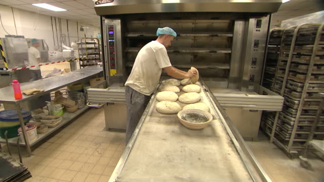 inteior shots of bread being baked in a traditional bakery on 23 august 2020 in bristol, united kingdom - brexit stock-videos und b-roll-filmmaterial