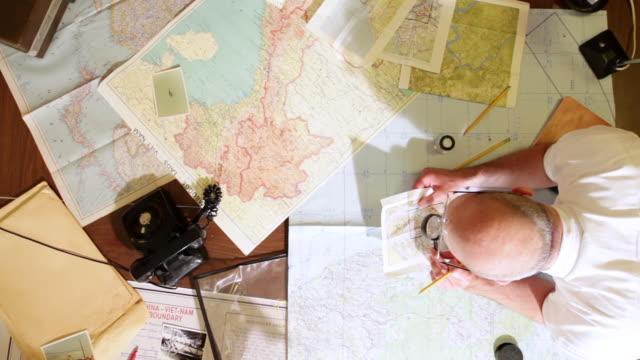 MS Intelligence analysts examining maps and documents / Philadelphia, Pennsylvania, United States