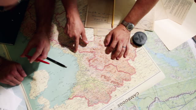 vídeos de stock e filmes b-roll de ms pan intelligence analysts examining maps and documents / philadelphia, pennsylvania, united states - mostrar