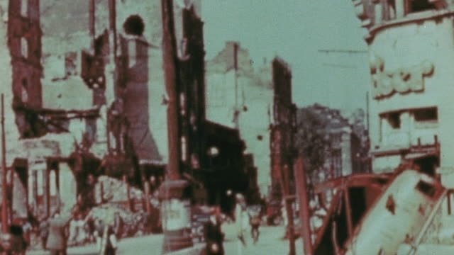 intense destruction in shopping area with crumbling store facades and pedestrians passing / berlin germany - 1945 stock-videos und b-roll-filmmaterial