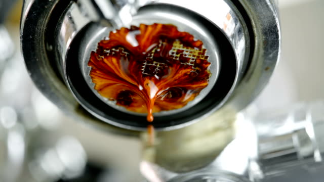 intense espresso coffee shot from machine close up. - preparation stock videos & royalty-free footage