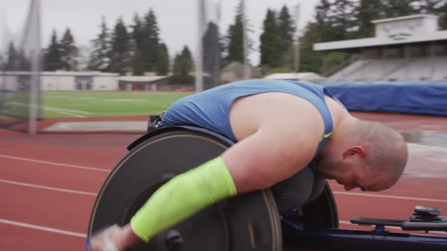intense male adaptive athlete racing down the track - body positive stock videos and b-roll footage