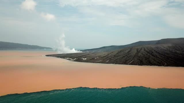 intense underwater volcanic activity turns the sea orange near anak krakatau volcano after major collapse and tsunami - undersea video stock e b–roll