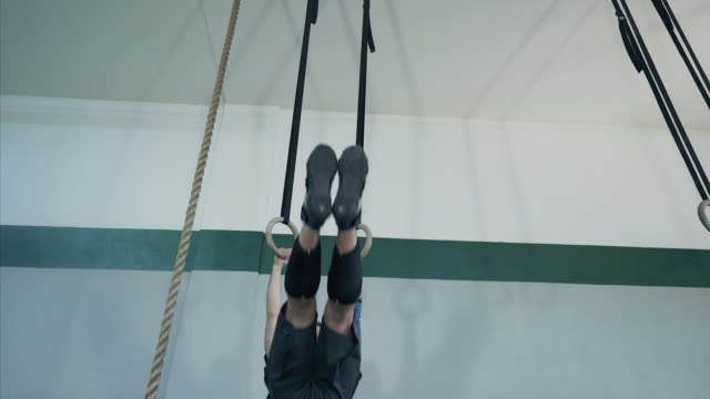 intense workout. - gymnastic rings stock videos & royalty-free footage