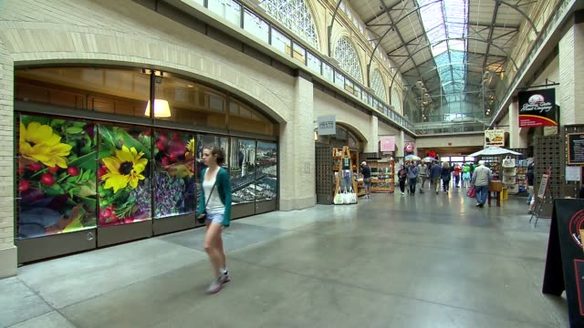 inter shots of the ferry building in san francisco on july 17 a wide shot of tourists walking through the hallway of shops in the ferry building a... - san francisco ferry building stock videos & royalty-free footage