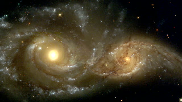 interacting spiral galaxies, hst view - galaxie stock-videos und b-roll-filmmaterial