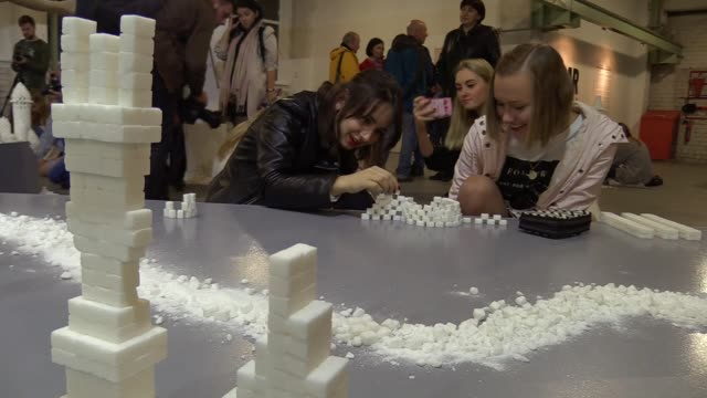 """interactive sculpture installation from sugar cubes """"sugar democracy"""",by artists from northern ireland brendan jamison and mark revels,was presented... - sugar cube stock videos & royalty-free footage"""